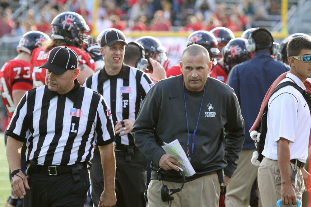 <p>Coach Danny Rocco stands on the sidelines during a Richmond victory.&nbsp;</p>