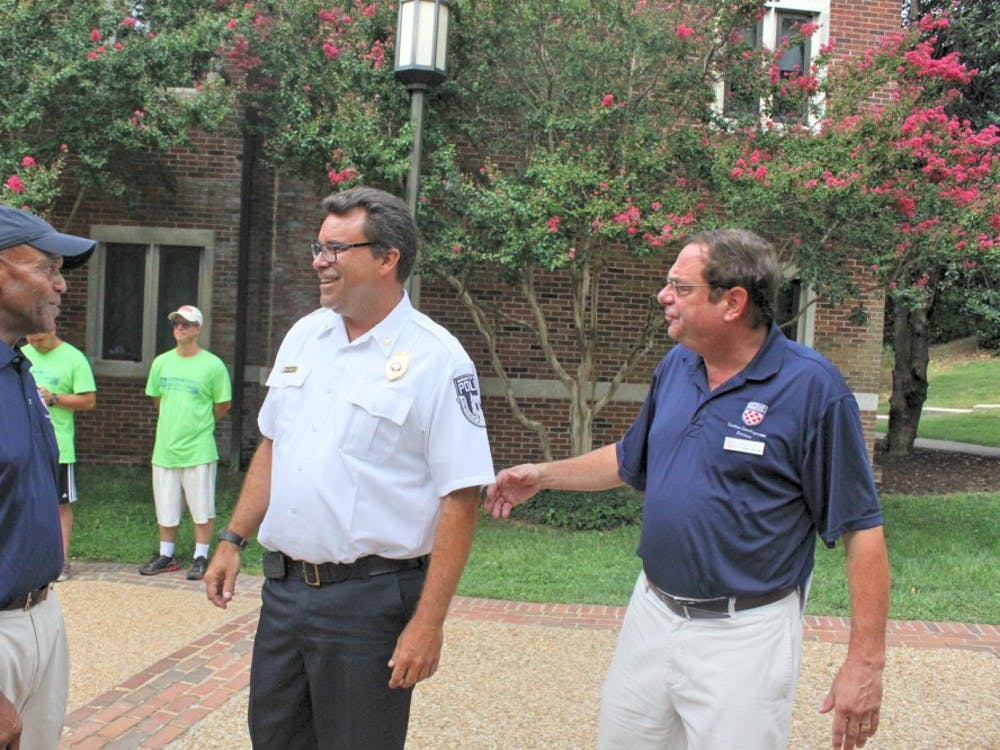 President Crutcher(left) and Steve Bisese (right),Vice President forStudent Development, ran into URPDChief Dave McCoy in front of Lora Robins