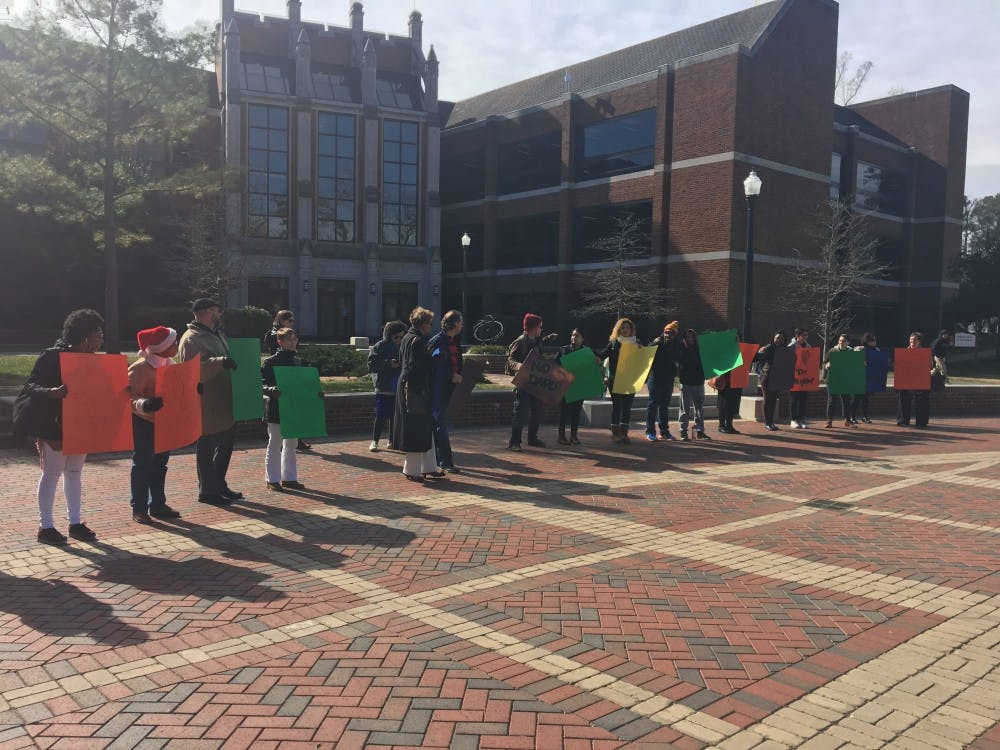 About 25 Richmond students, faculty and staff marched on the university forum Friday morning in solidarity against President Trump's recent executive orders.