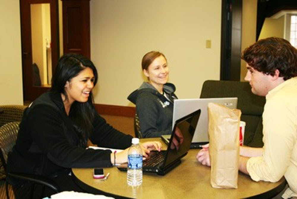 Michelle Garcia, Alisa Emelianova and Adam Ferguson enjoy their lunch and do work in the second floor lounge of Lakeview Hall.
