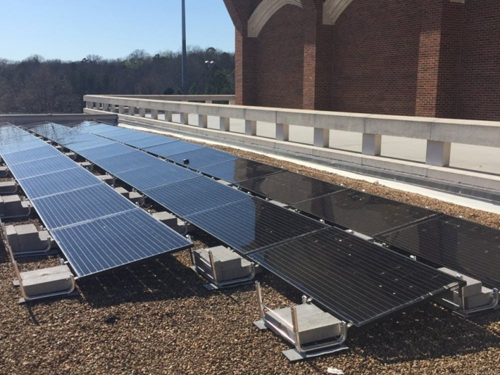Solar panels on top of the Weinstein Center will finish being installed by the end of March. Photos by Ashlee Korlach.