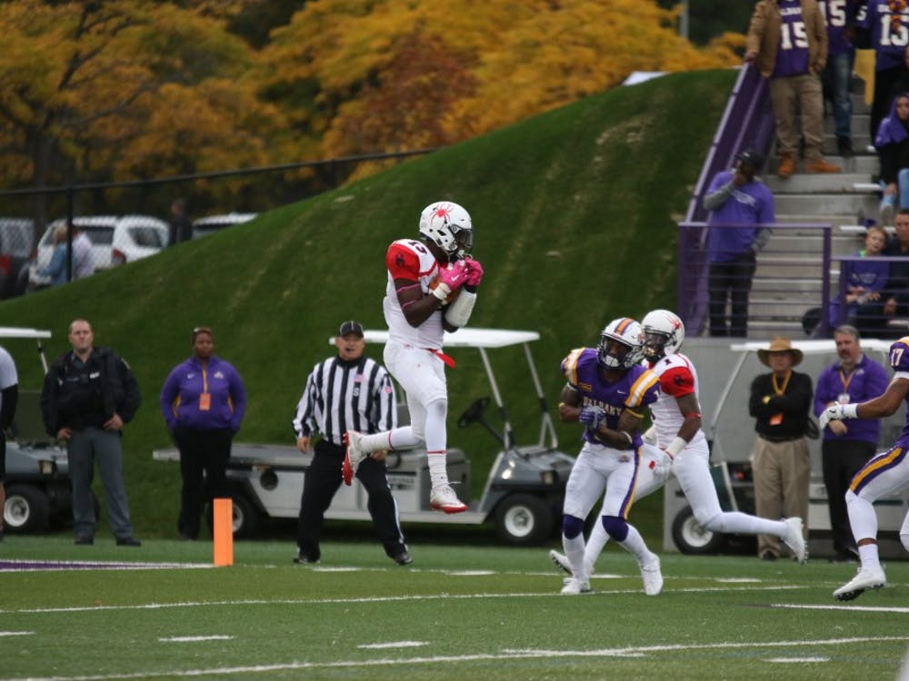 David Jones jumps for an interception to end the first half against Albany last season. Jones suffered an injury during the game that would end his season.