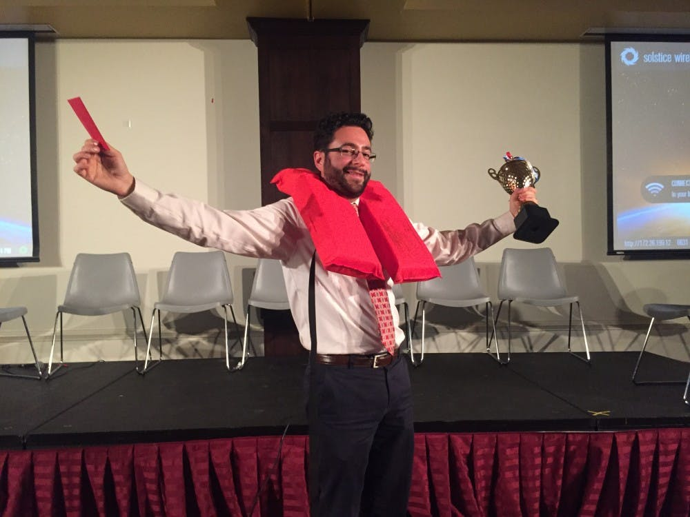 Department of physics' Jack Singal is crowned the champion at UR'S first professor life raft debate.