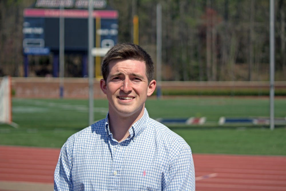 <p>Griffin Trau stands in front of E. Claiborne Robins Stadium where he played on UR's football team as kicker for four seasons.&nbsp;</p>