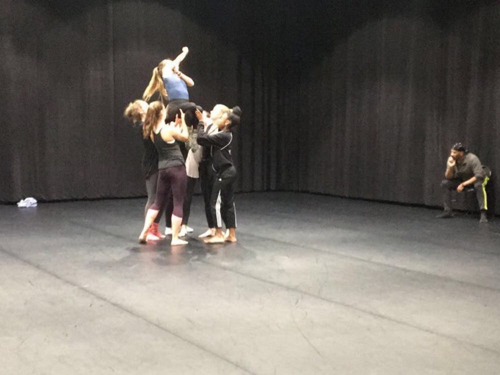 Nine members of the University Dancers work with choreographer Christian von Howard to rehearse his piece, which will be performed at their annual show in March.