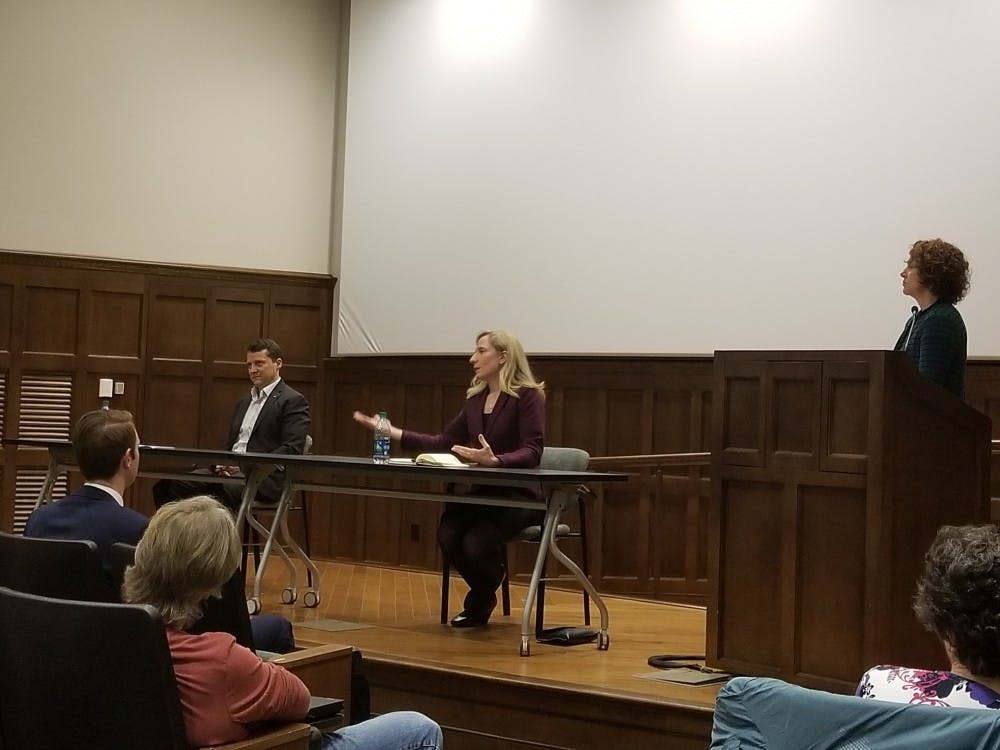 <p>Democratic congressional&nbsp;candidate Dan Ward, left, and professor Tracy Roof, right, listen to another Democratic congressional&nbsp;candidate,&nbsp;Abigail Spanberger, center, respond to a debate question in Ukrop Auditorium on April 2.&nbsp;</p>