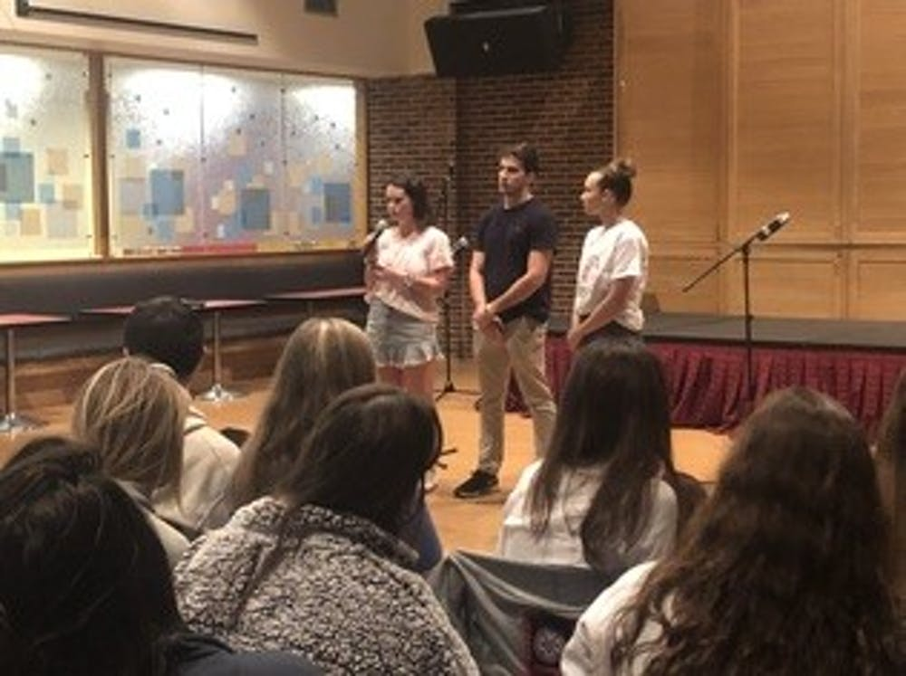 <p>WCGA President Monica Stack (left), IFC President Dan Mahoney and CAPS intern Ally Charleston address students at the second annual In My Mind event.</p>