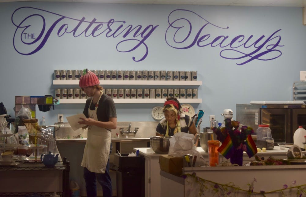 <p>Employees fill orders inside of the Tottering Teacup.</p>
