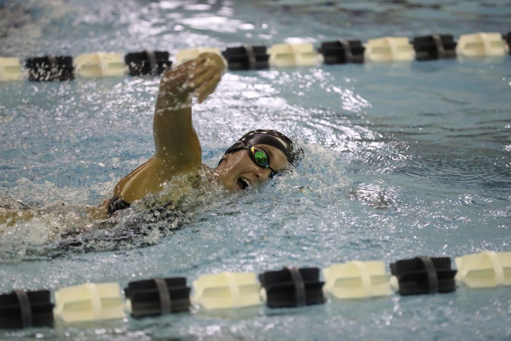 <p>Sophomore Nicole Piercy swims in a freestyle race earlier this year. She was named A-10 Rookie of the Year her freshman season. Photo courtesy of Richmond Athletics.</p>