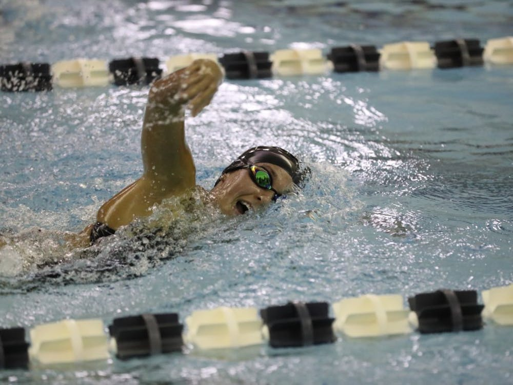 Sophomore Nicole Piercy swims in a freestyle race earlier this year. She was named A-10 Rookie of the Year her freshman season. Photo courtesy of Richmond Athletics.