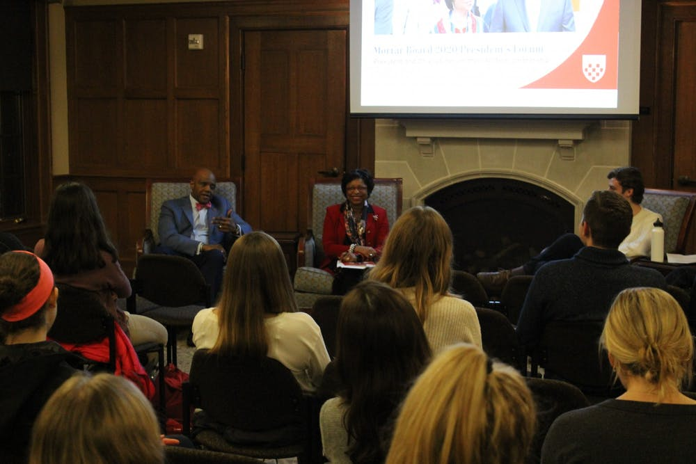 <p>University President Ronald A. Crutcher (left) and Dr. Betty Neal Crutcher speak during the Mortar Board's President's Forum on Feb. 10.&nbsp;</p>