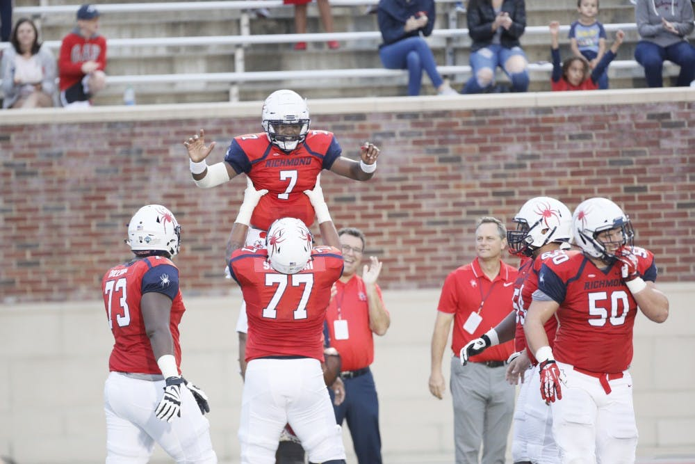 <p>Dominant defensive play and a four-touchdown performance by quarterback Kevin Johnson (7) led the University of Richmond football team to a 52-7 victory over the Fordham Rams Saturday night in the Spiders' home opener.</p>