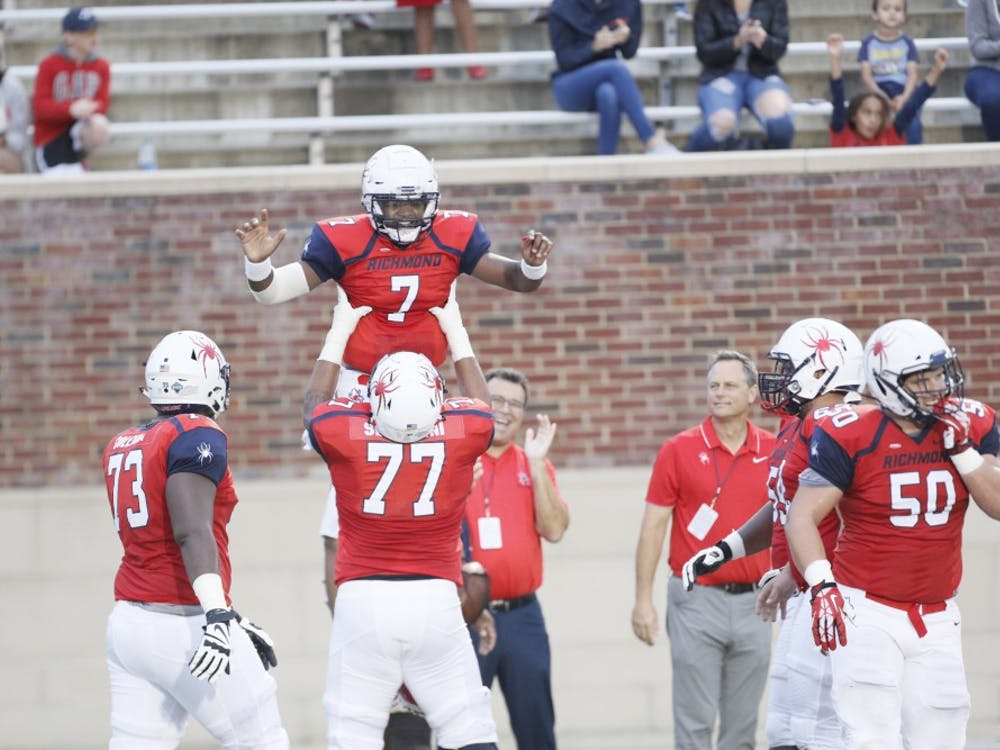 Dominant defensive play and a four-touchdown performance by quarterback Kevin Johnson (7) led the University of Richmond football team to a 52-7 victory over the Fordham Rams Saturday night in the Spiders' home opener.