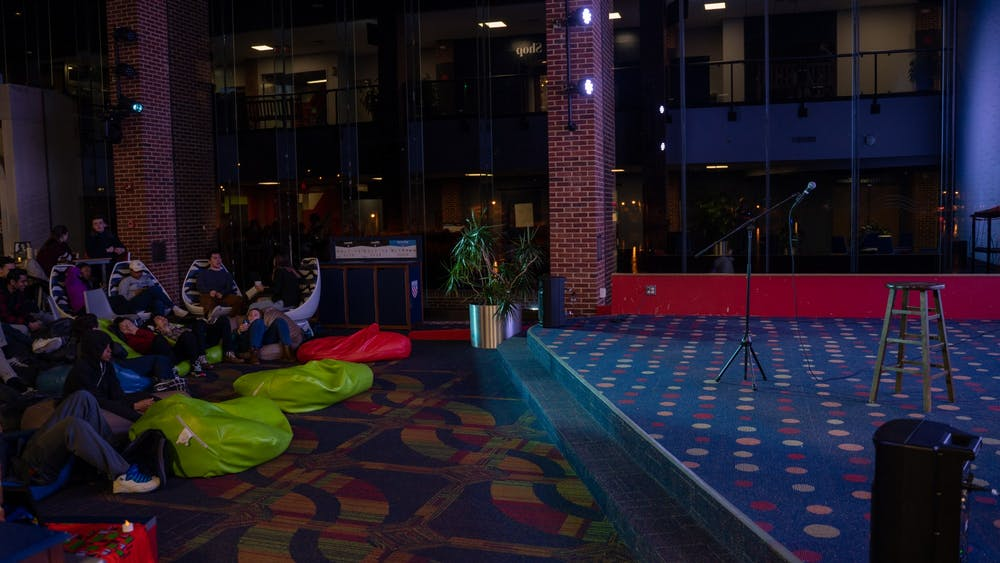 <p>Students gather for the For the Culture open microphone night.</p>