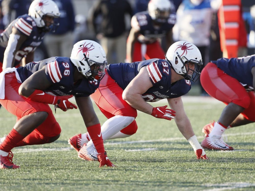 Junior Maurice Jackson (right) and redshirt senior Andrew Clyde during the football team's loss to the University of Maine on Saturday, Nov. 10.