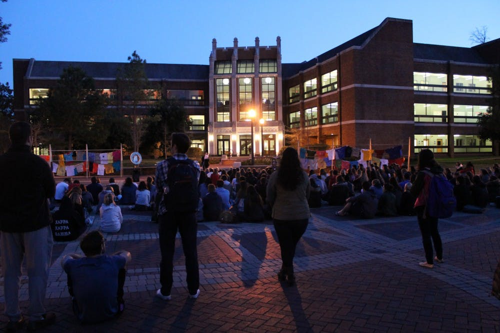 <p>Students gather to listen as survivors of sexual violence and their allies&nbsp;share their stories at Take Back the Night in the Forum.&nbsp;</p>