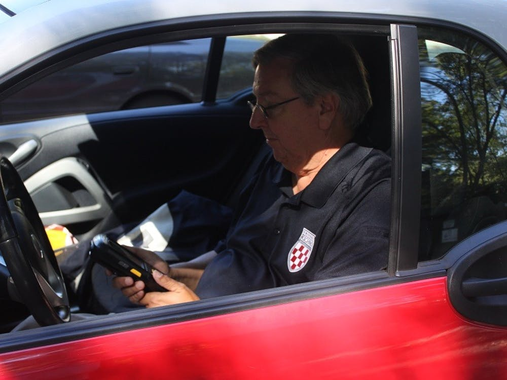 Bill Rawluk, Richmond's parking enforcement specialist, has been writing parking tickets for 14 years at the university. Few know him, and many resent him.