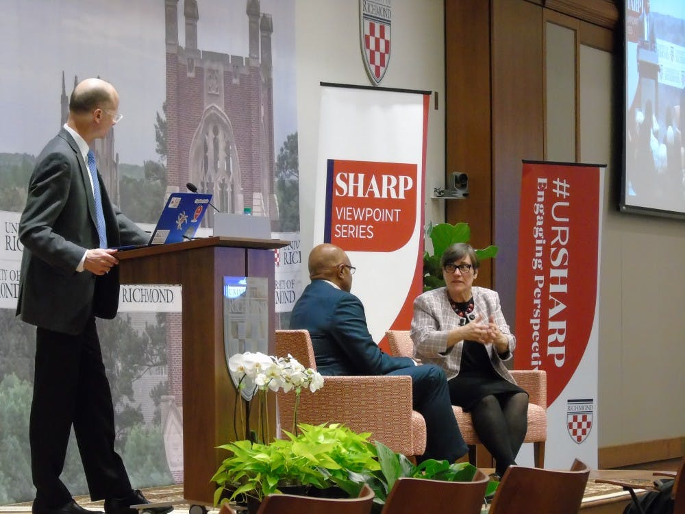 <p>Paula Krebs (right) speaks with President Ronald A. Crutcher (middle) and Executive Vice President and Provost Jeff Legro.</p>