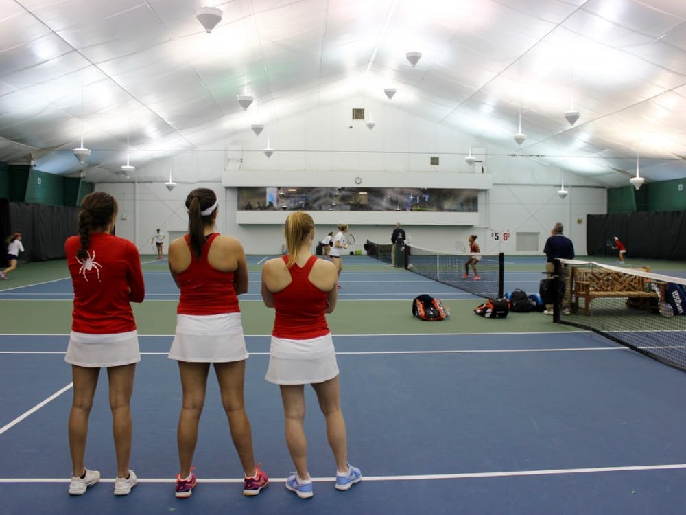 Richmond players watch the end of the two doubles matches which both end in wins.
