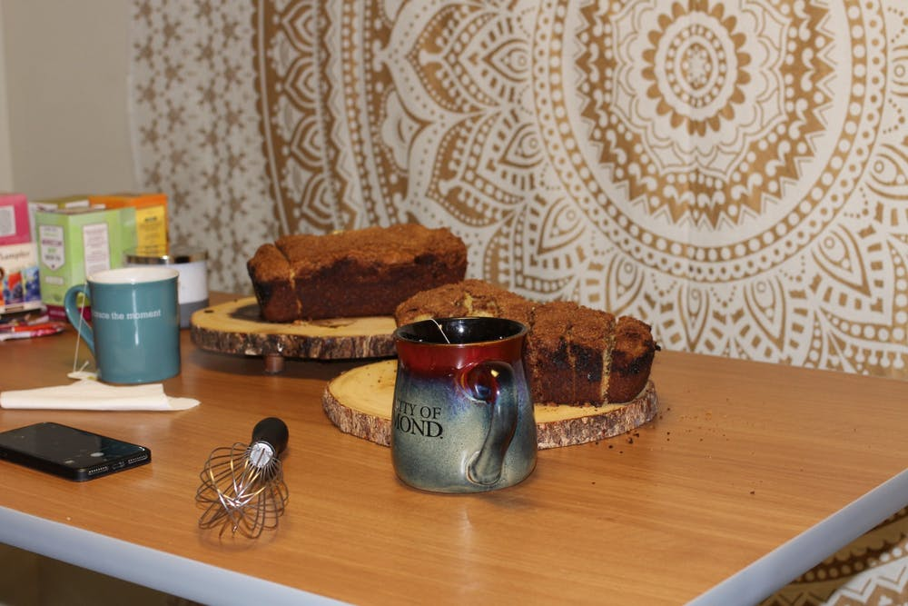 <p>Freshly baked bread and mugs full of hot tea are on display at one of senior Callie Cinque's popular Tea &amp; Bread nights.&nbsp;</p>