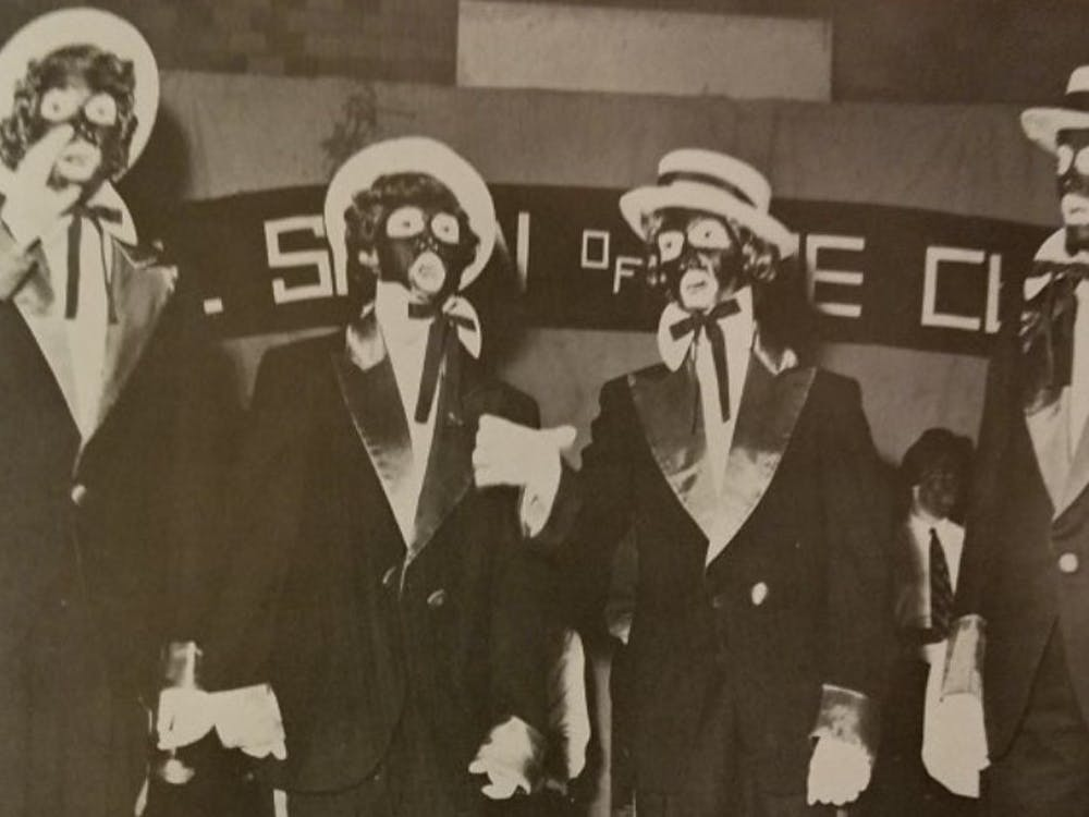"An image of students in blackface, originally published in 1964 The Web yearbook. The image was displayed during the ""Our History Untold"" event."