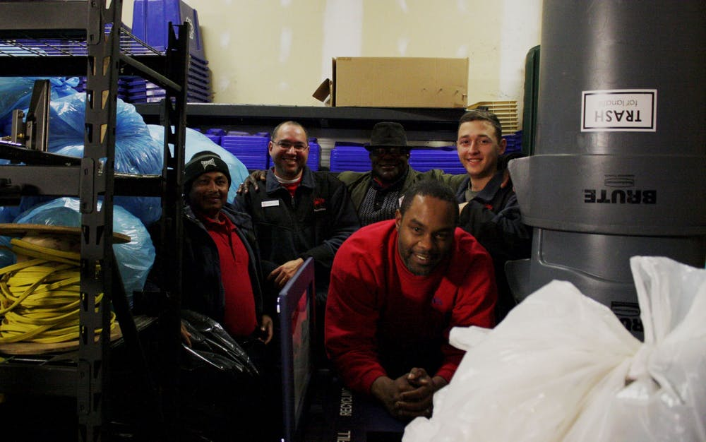 <p>Facilities employees Wa Hit, Mauricio Lopez, James Campbell, John Shines and Jonathan LaPrade (left to right) pose with bags of plastic collected for the Trex initiative in the physical plant storage room where the bags are kept until distribution.</p>