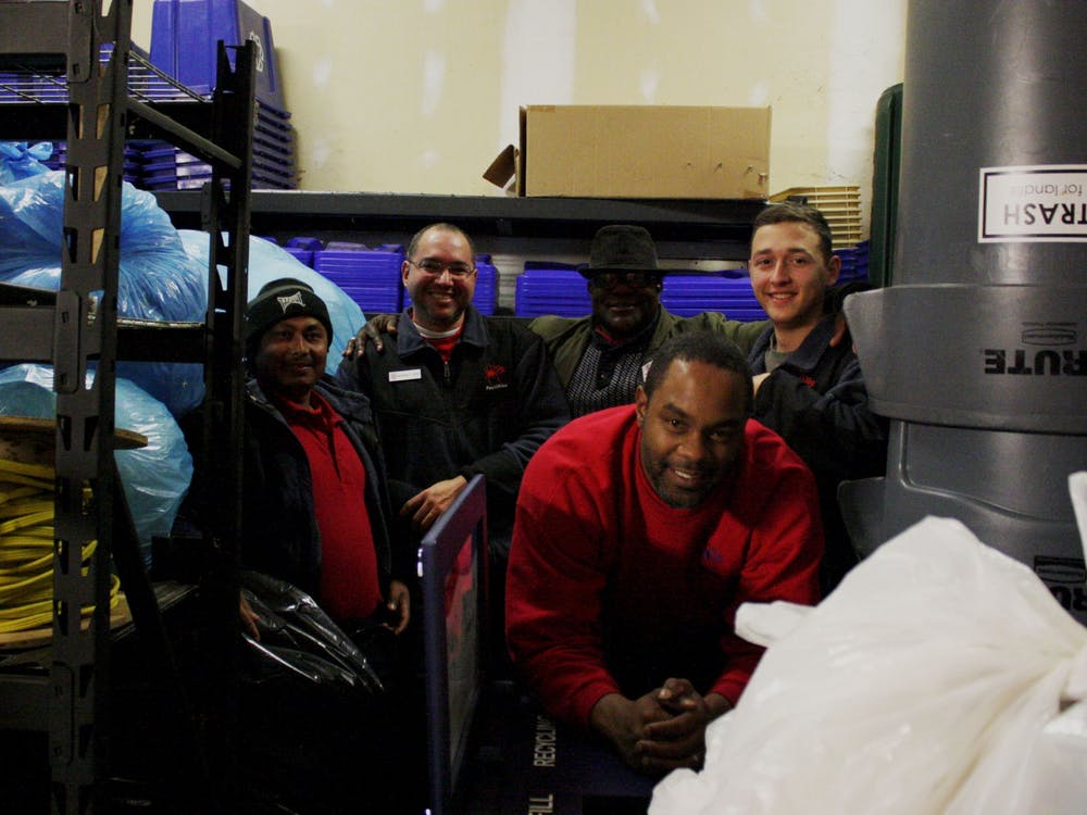 Facilities employees Wa Hit, Mauricio Lopez, James Campbell, John Shines and Jonathan LaPrade (left to right) pose with bags of plastic collected for the Trex initiative in the physical plant storage room where the bags are kept until distribution.