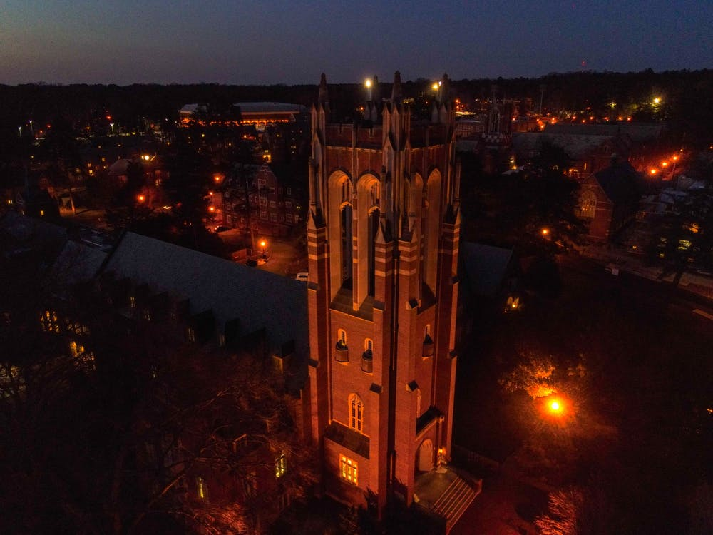 The tower at Boatwright Memorial Library glows on a March night.