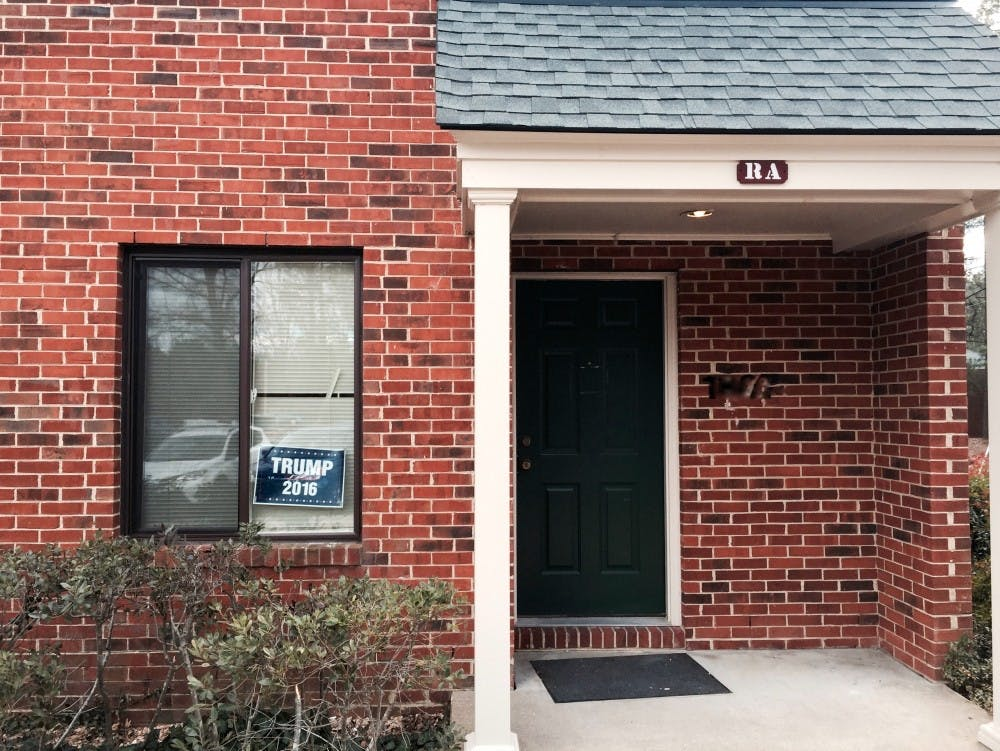 <p>A Trump campaign sign sits in the window of a University Forest Apartment.&nbsp;</p>