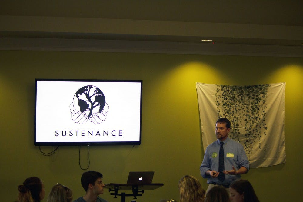<p>Director of Sustainability Rob Andrejewksi speaks at the Office of Sustainability banquet.</p>