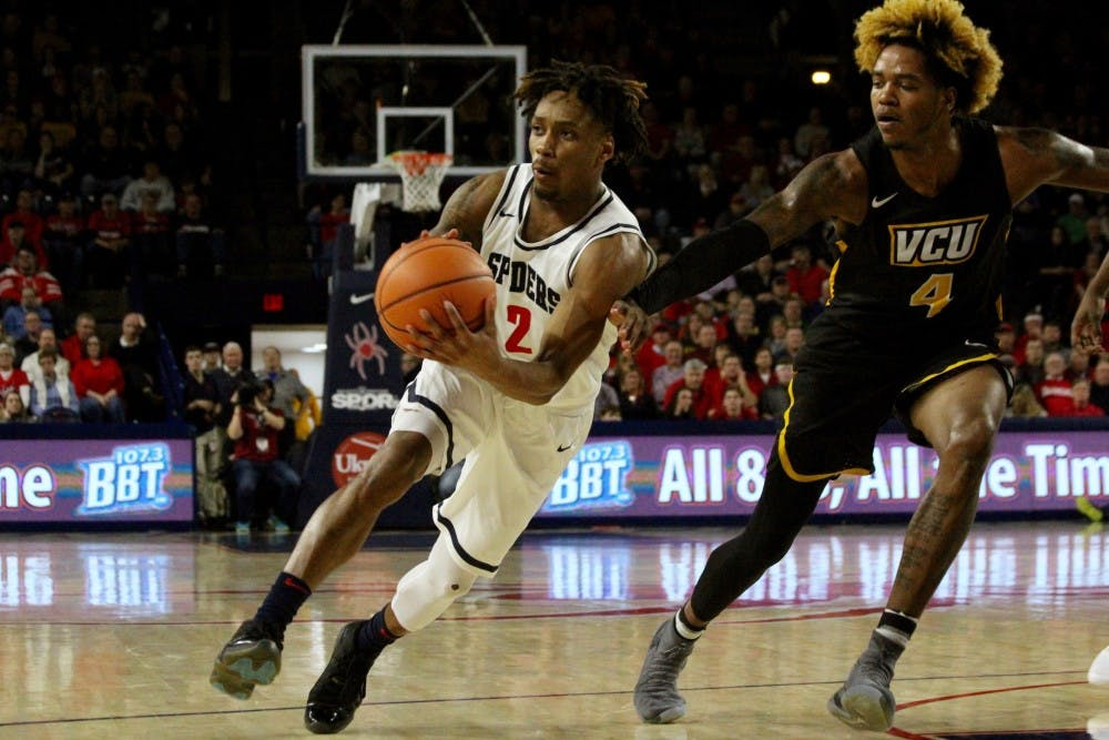 <p>Junior guard&nbsp;Khwan Fore looks to make a pass during the&nbsp;Wednesday night&nbsp;game, resulting in a win&nbsp;against VCU.</p>