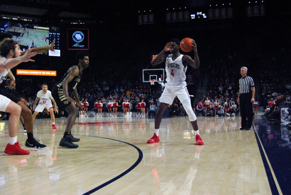 <p>Sophomore forward Nathan Cayo receives a pass during the Spiders' win Wednesday, Dec. 5 against Coppin State.&nbsp;</p>