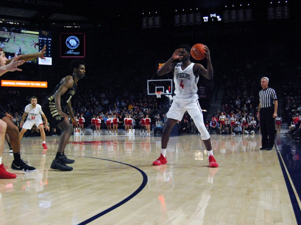 Sophomore forward Nathan Cayo receives a pass during the Spiders' win Wednesday, Dec. 5 against Coppin State.