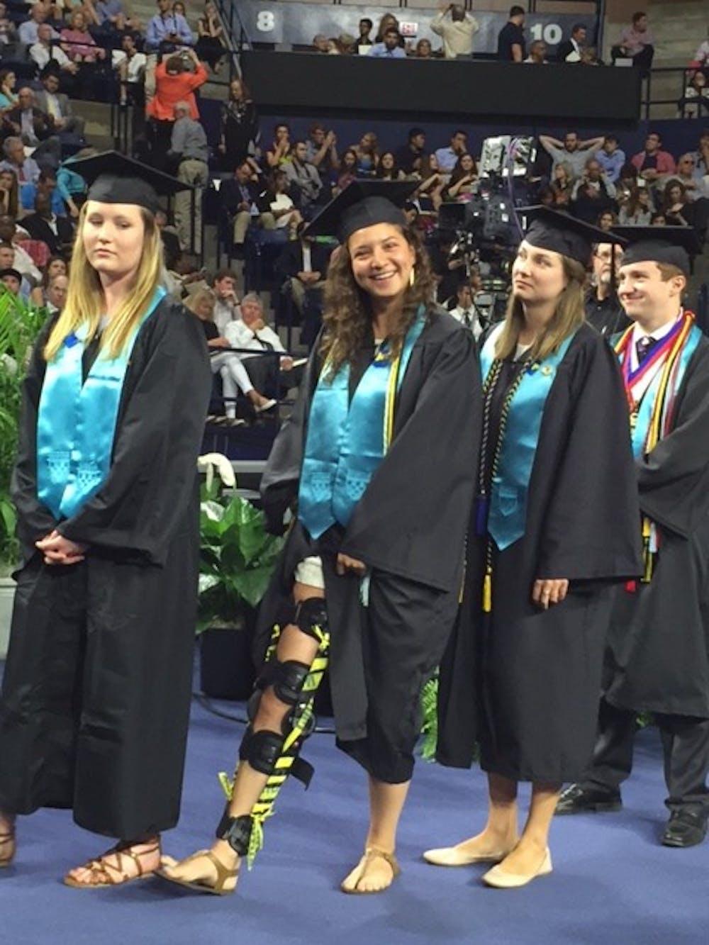 <p>Kobb, walks with her leg brace&nbsp;amongst fellow Jepson seniors at graduation on May 8, 2016.</p>