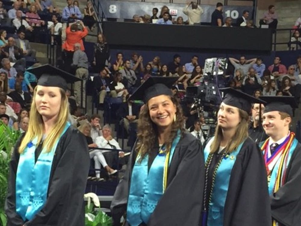 Kobb, walks with her leg brace amongst fellow Jepson seniors at graduation on May 8, 2016.
