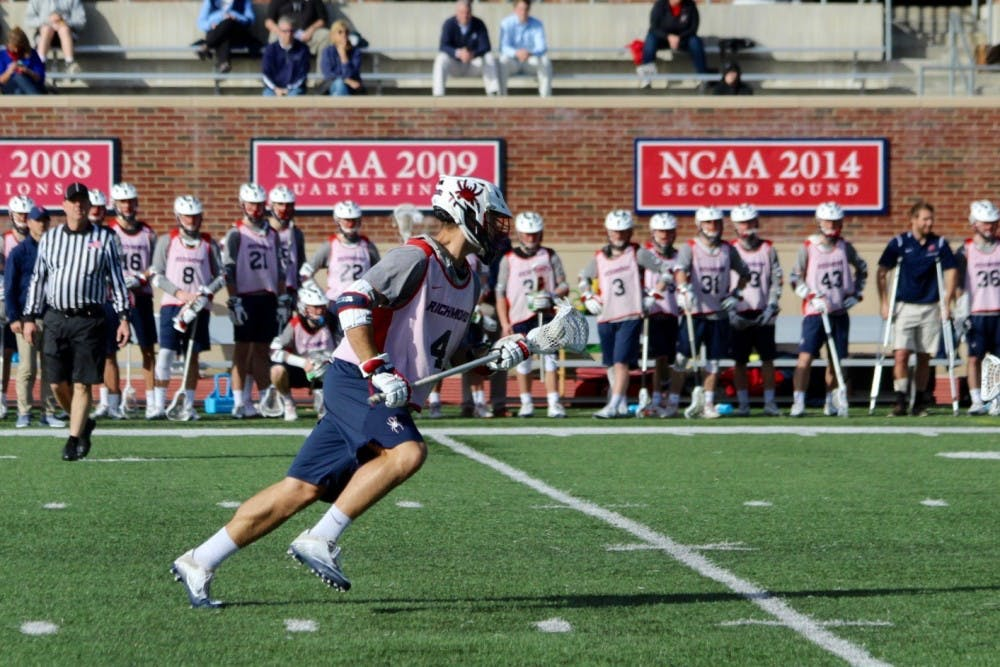 <p>Senior midfielder Eric Haehl runs the ball down the field.&nbsp;</p>