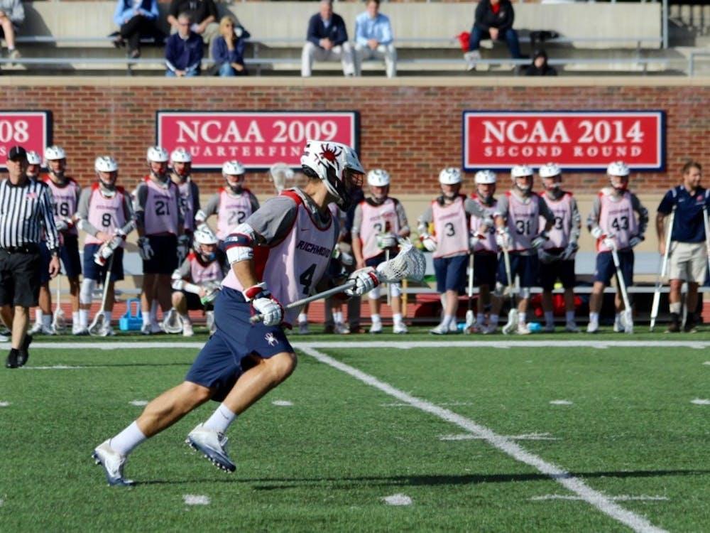 Senior midfielder Eric Haehl runs the ball down the field.