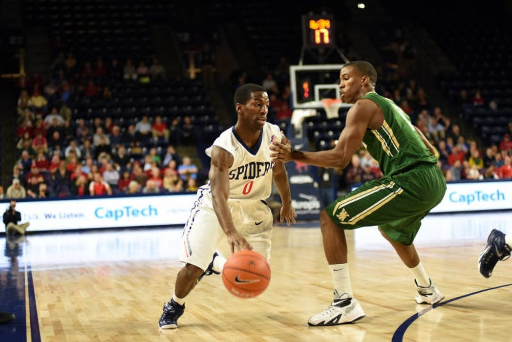 "<p>""Richmond point guard Kendall Anthony drives toward the basket past the William and Mary defense."" Photo courtesy of Richmond Athletics.</p>"