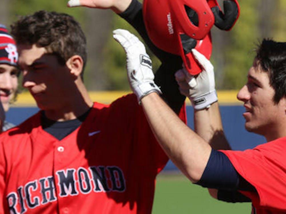 The Richmond baseball team celebrates a win.