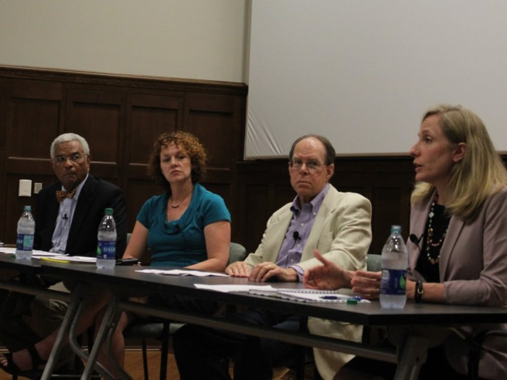 Democratic congressional candidate Abigal Spanberger, far left, speaks about the high cost of drugs as other panelists, from the right, Harry Bear, Tracy Roof and Larry Palmer listen.