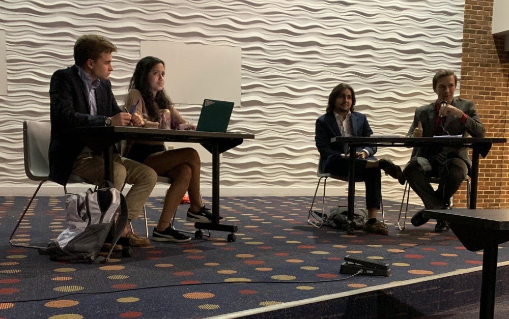 <p>The University of Richmond College Democrats pictured on the left, Riley Place and Val Zuluaga, and the College Republicans pictured on the right, Rob Papandrea and Carl Wagner, debate policy issues at Wednesday's event.</p>