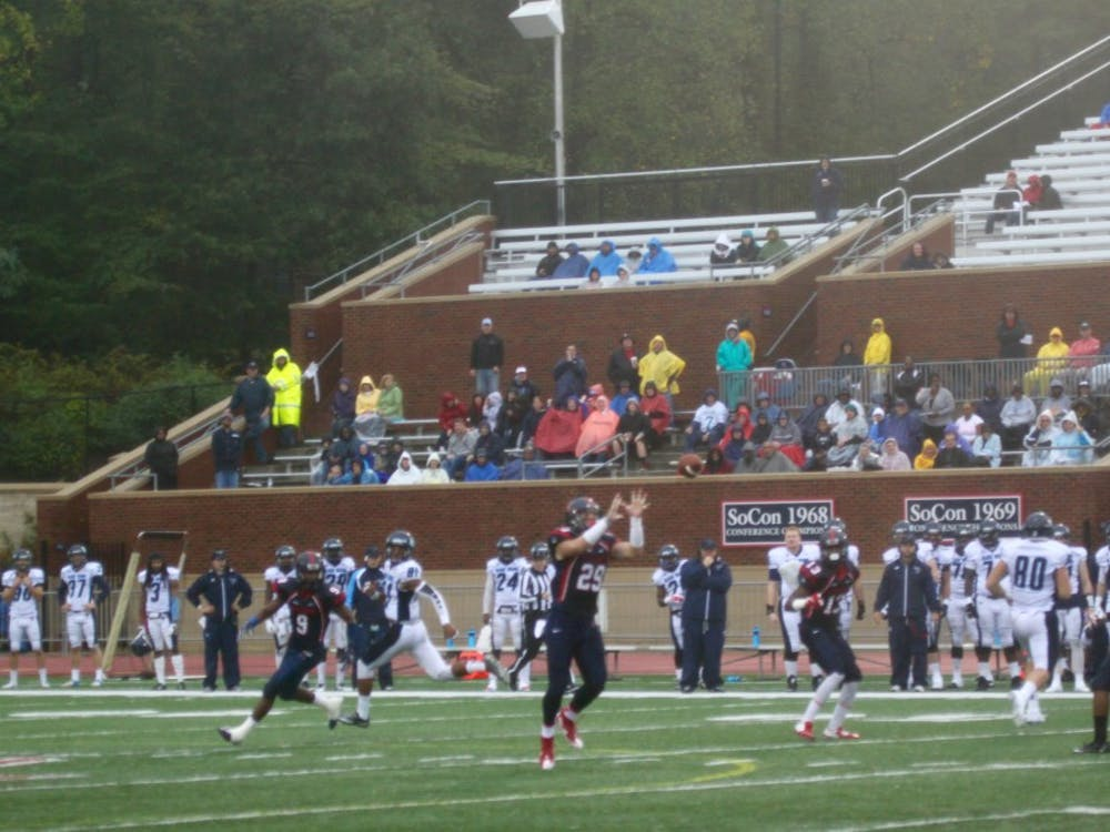 Justin Rubin awaits an interception during the second quarter as the few poncho-covered fans look on. Richmond has been in control for the majority of the game.