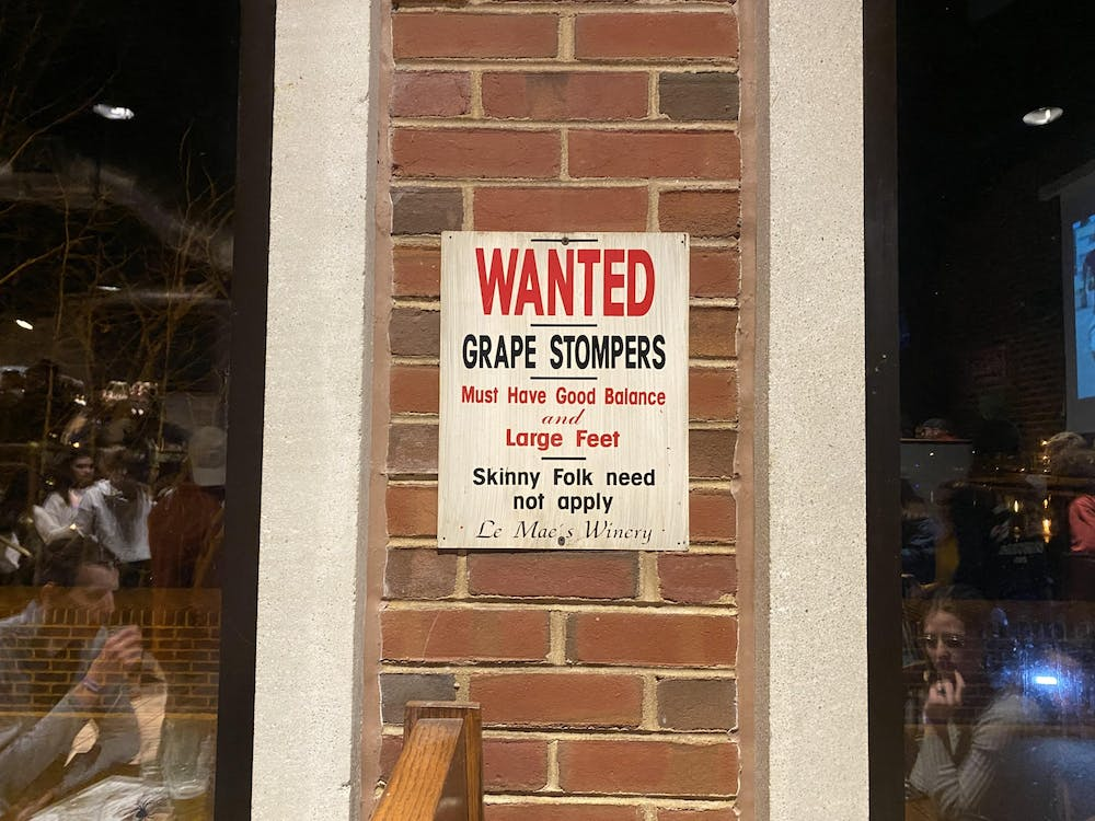 """<p>A now-removed sign in The Cellar reads, """"Wanted grape stompers must have good balance and large feet skinny folk need not apply Le Mae's winery."""" The sign was removed in late January after The Cellar received reports that certain signs were offensive.&nbsp;</p>"""
