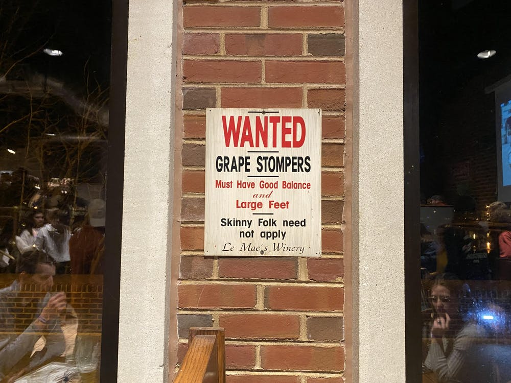 "A now-removed sign in The Cellar reads, ""Wanted grape stompers must have good balance and large feet skinny folk need not apply Le Mae's winery."" The sign was removed in late January after The Cellar received reports that certain signs were offensive."