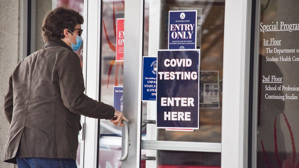 A student enters the Special Programs building, where prevalence tests are administered.