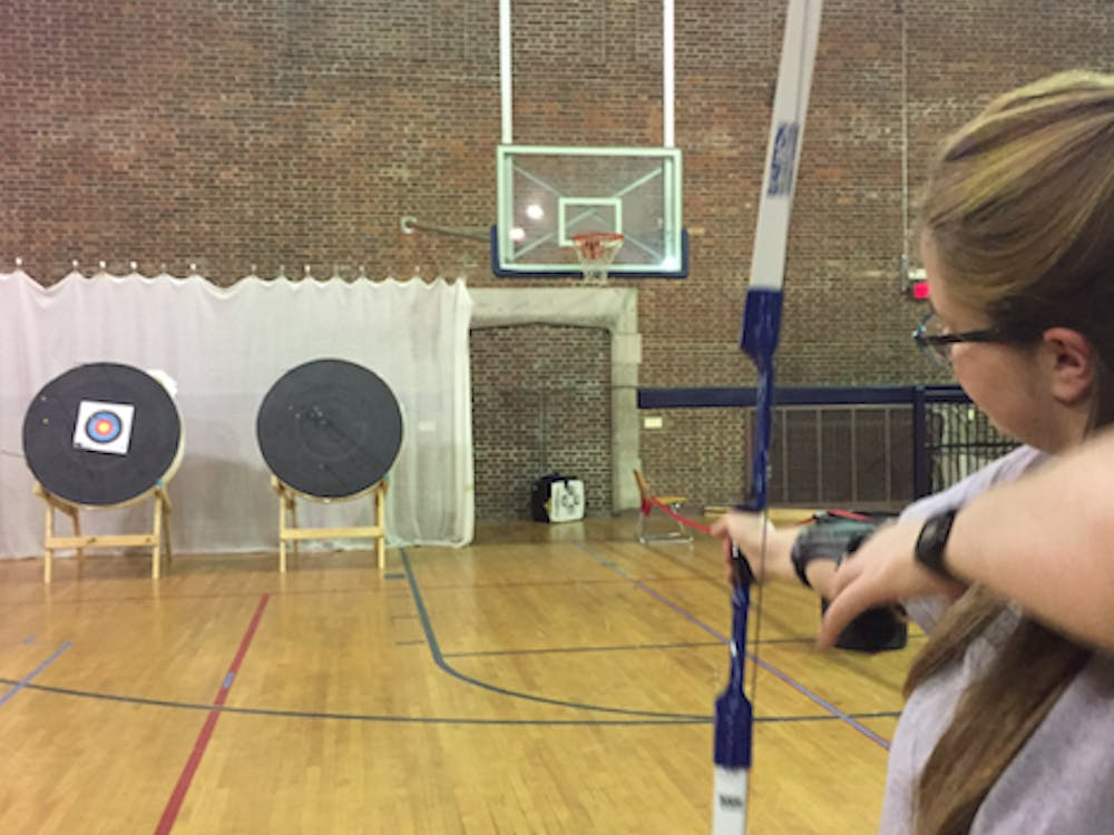 Tess Ferrer aims at a target from a distance of about 8 meters.