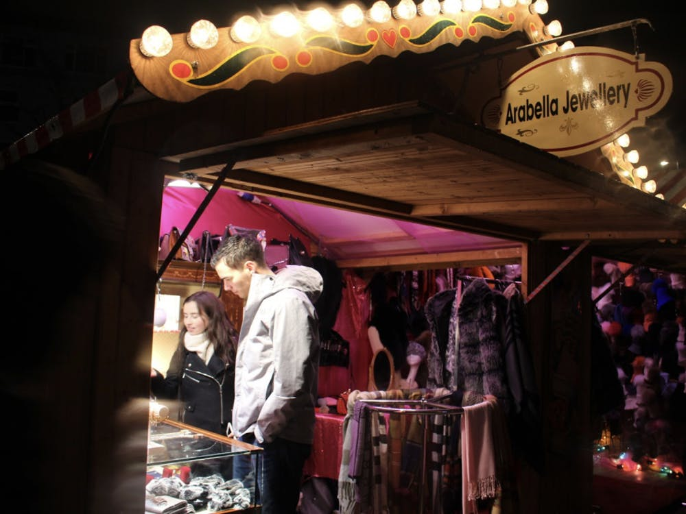 Two UR study abroad students, juniors Nicole Murgia and Kevin Mudrick, looked in a market stand for Christmas gift ideas from both local and European traders.
