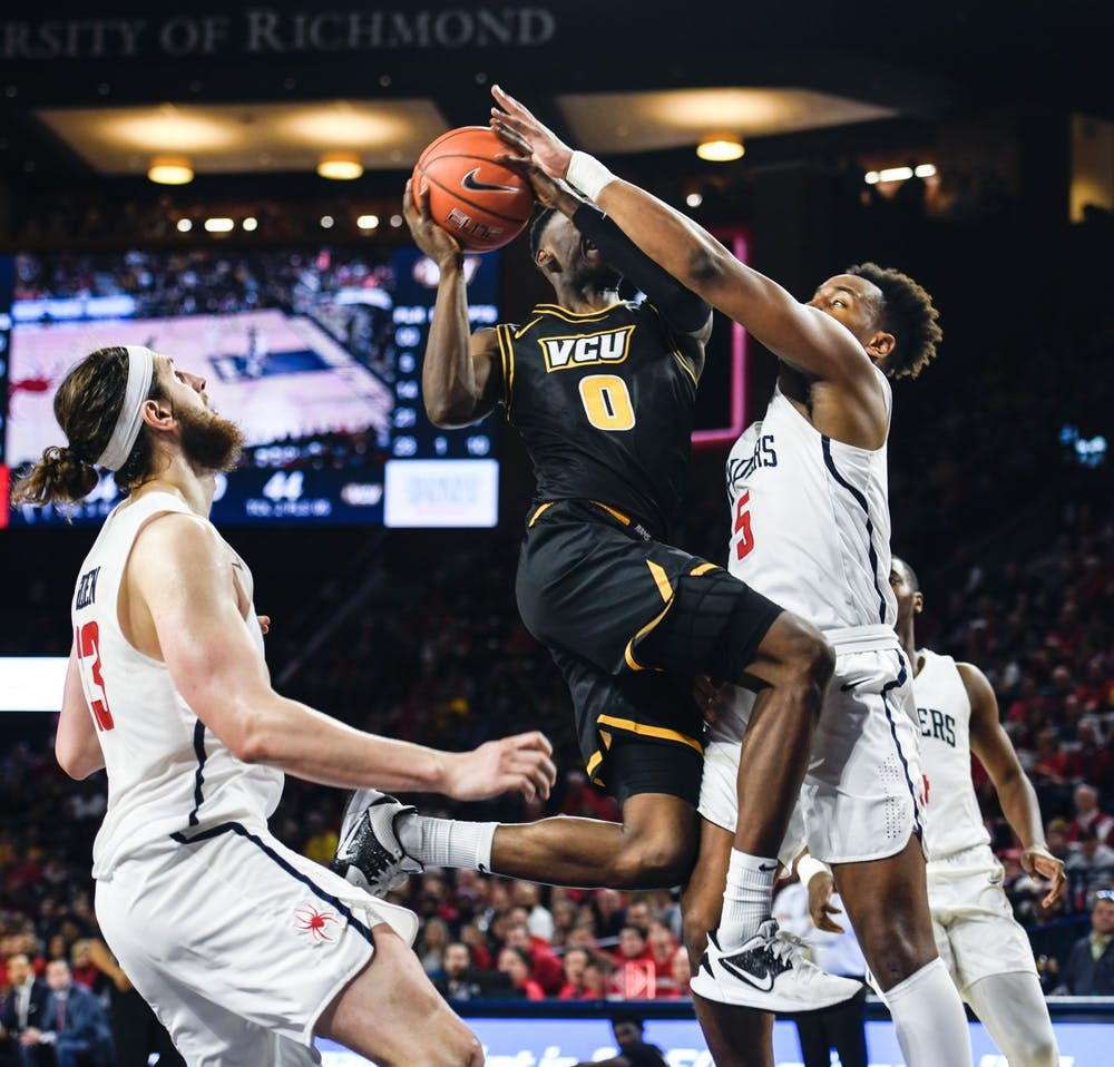 Redshirt junior guard Nick Sherod reaches to block a shot by VCU during a game at the Robins Center on Saturday, February 15, 2020.