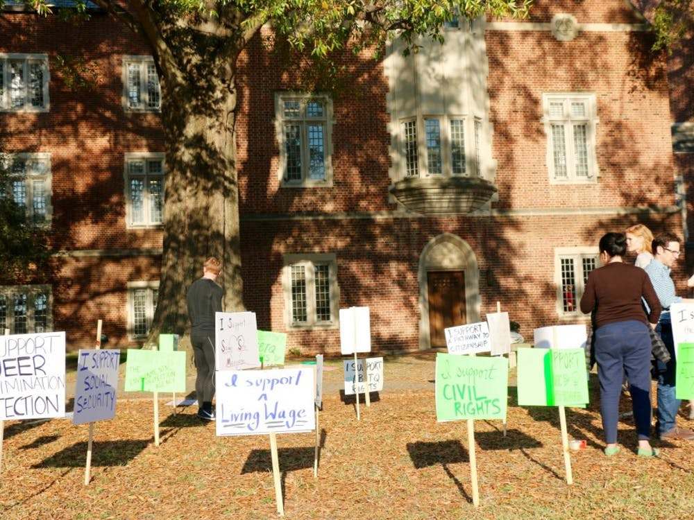 Students, faculty and staff organized outside Boatwright Memorial Library to positively protest the presidential election.