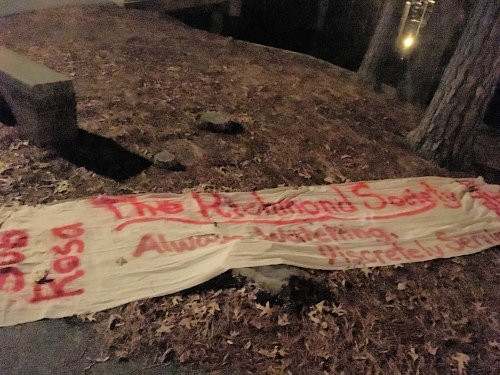 <p>The banner found by The Collegian near the gazebo over Westhampton Lake.</p>
